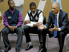 Atty. Gen. Eric H. Holder Jr. meets with young men of color at the Brotherhood Crusade Youth Source Center in the Crenshaw district of Los Angeles. (Luis Sinco, Los Angeles Times)